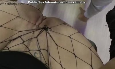 Brunette banged with two cocks twhorugh holes in her tights